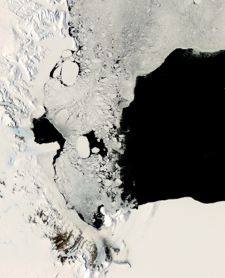 Sea ice covers a large part of the Ross Sea in this summer 2007 photo. A large opening in the ice cover, or polynya, extends to the east. Photo courtesy of NASA.
