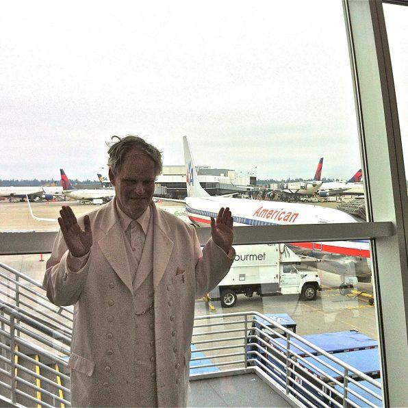 White suit, white plane.