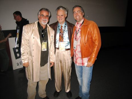 Vincent trades coats with BendFilm board members Bob Lane and Scott Ramsay.