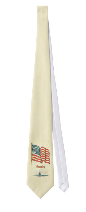 Patriotic neck tie with the American flag over the Statue of Liberty on an off white background.