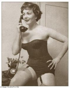 Corseted girl on telephone
