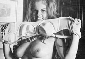 Vintage babe removes her bra