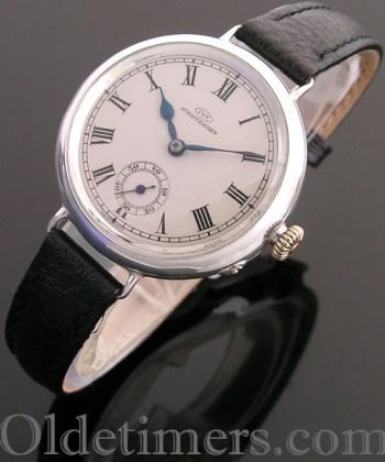 1920s round silver vintage IWC watch