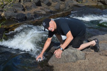 Rod collects water from the Coomera River