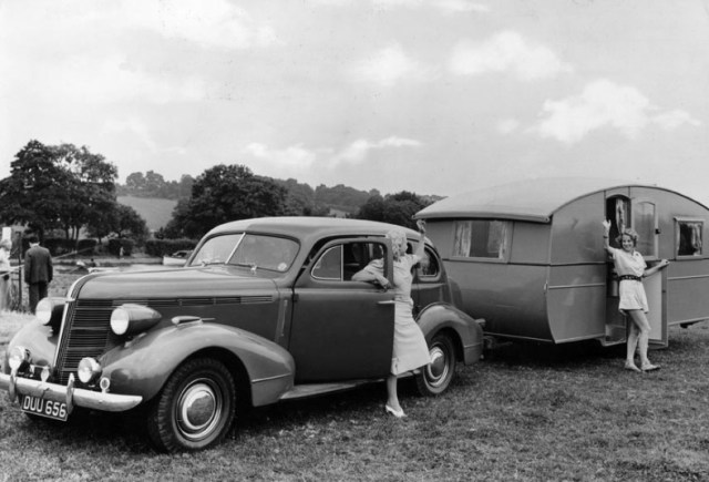 1939: Two women wave to each other after arriving on holiday with their caravan