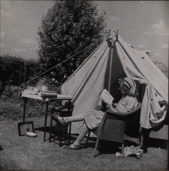 reading a book while vintage camping