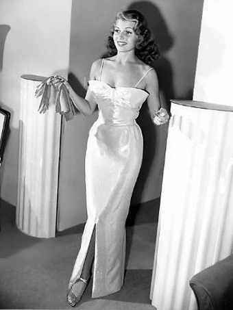 Rita Hayworth in 1941 wearing a pink & silver lamé gown