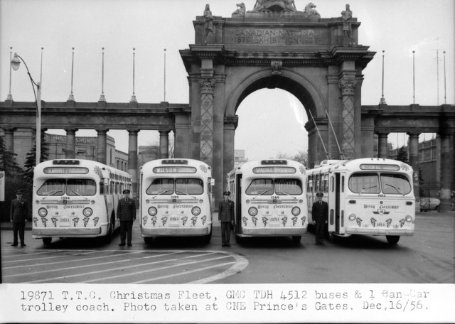 T.T.C. Christmas Fleet, G.M.C. TDH 4512 buses and 1 Can-Car trolley coach. Photo taken at C.N.E. Prince's Gates, [Toronto, Ont.] Dec. 16, 1956.