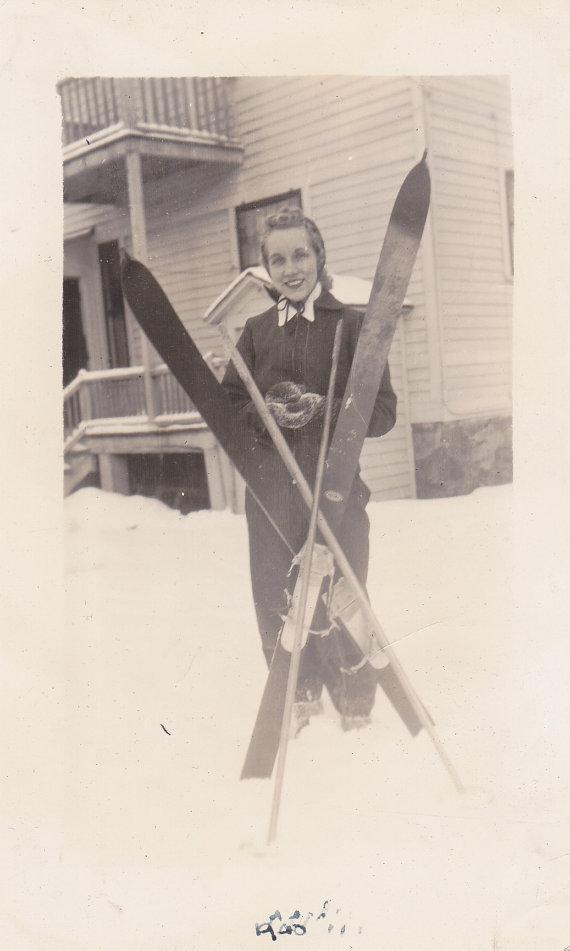 1940s vintage image of a woman skier. woman ski fashion