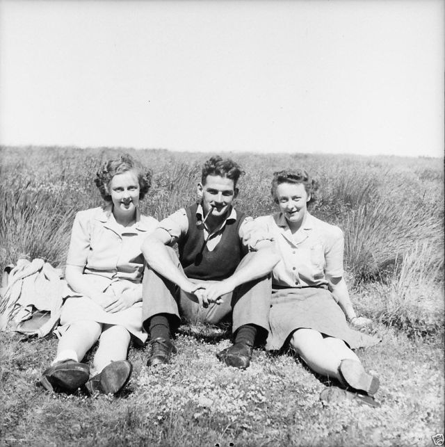 1940s vintage image of 2 women and one man