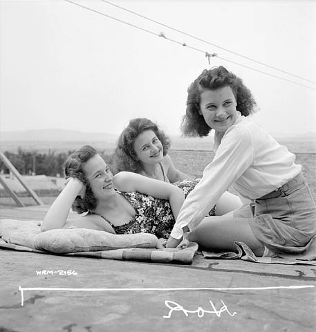 1940s-vintage-image-of-women-in-swimsuits-and-summer-clothes-canada