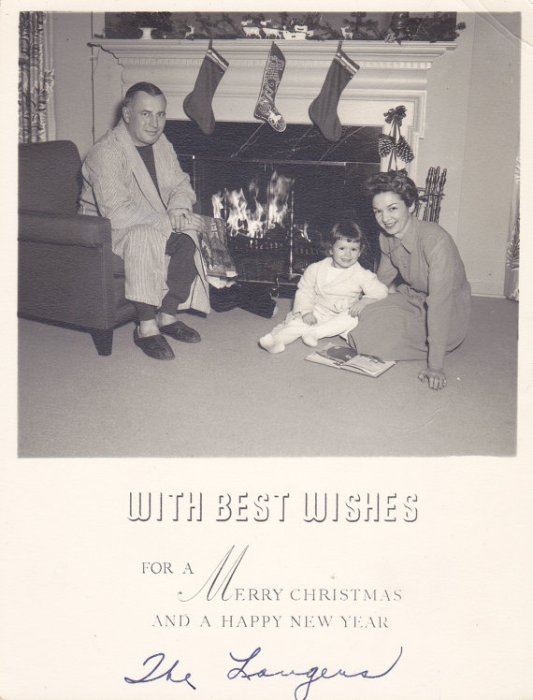 1940s vintage image of family by fireplace
