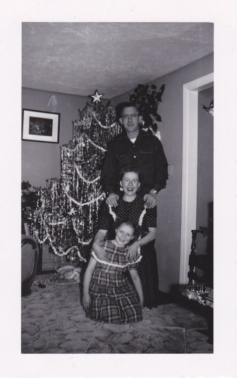 1950s family with tinsel tree vintage image