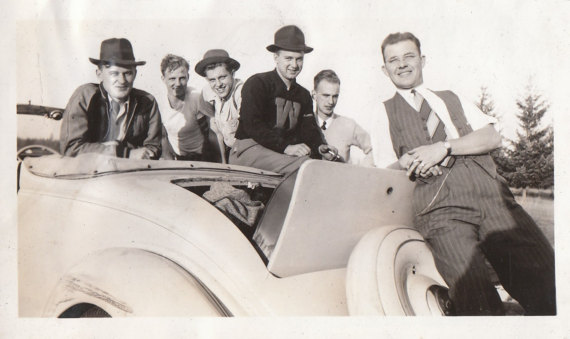 1930s vintage image of men with their car