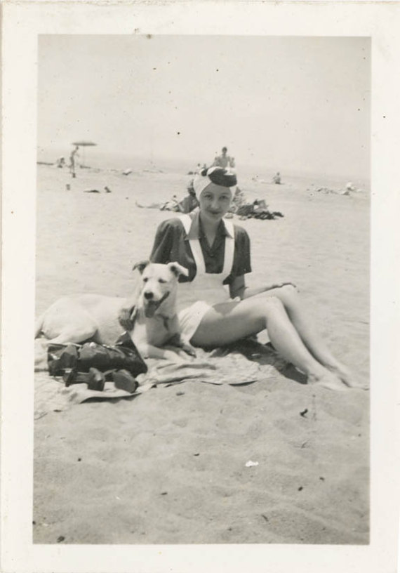 1940s vintage image of woman on the beach with dog