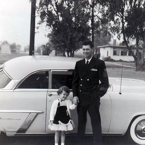 1950's little girl with dad in front of vintage car, vintage image