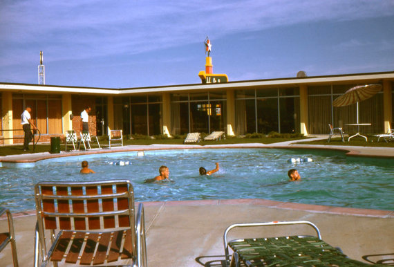1960s vintage holiday inn family photo by the pool