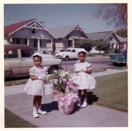 1960s two little girls in their easter dresses vintage photo
