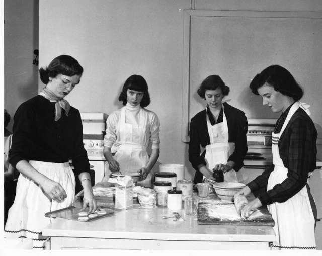 University of Nashville Photograph of four female students in action during a home economics class 1950s