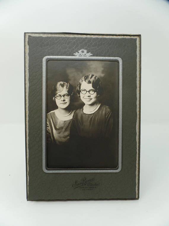 1927 vintage image of two young women wearing glasses
