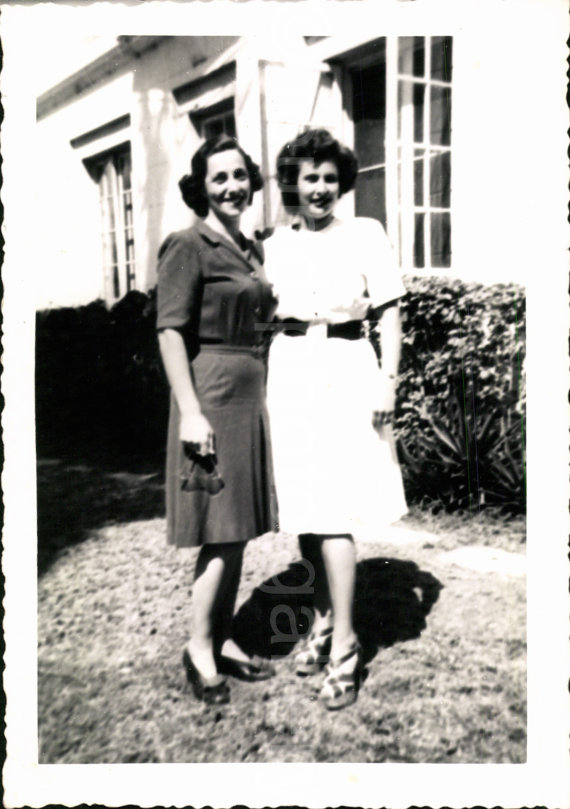 1940s vintage image of 2 women in front of house