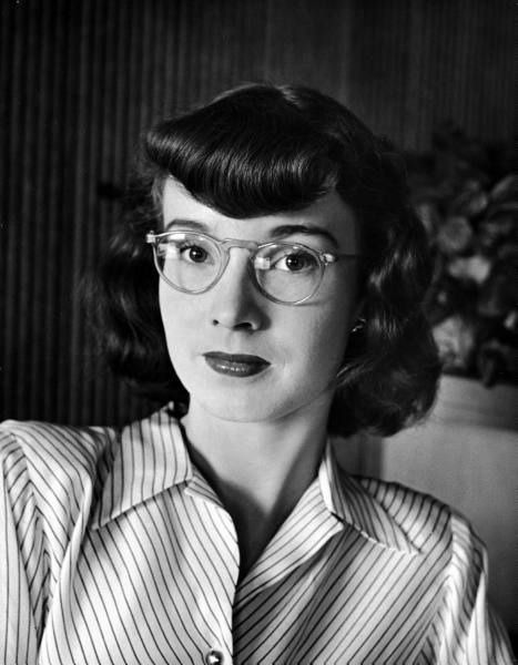 1945 life magazine image of young woman wearing glasses
