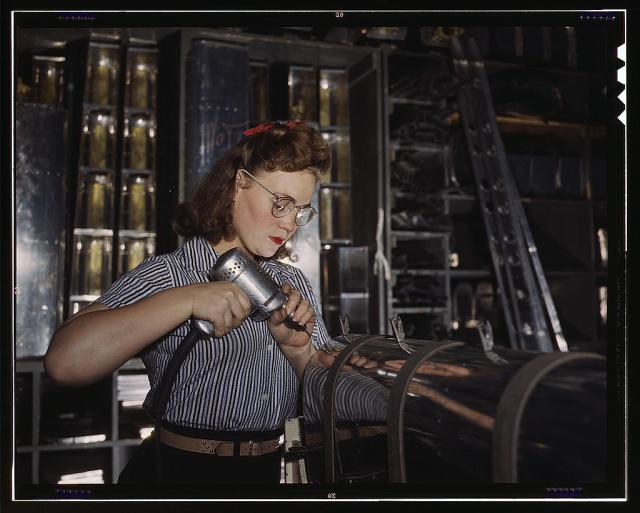 1940s vintage image of a woman working in a plant during the war