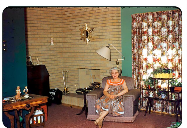 1956 vintage photo of an older woman in her living room
