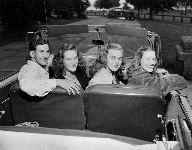 Vintage image of 4 young people in a car in 1948