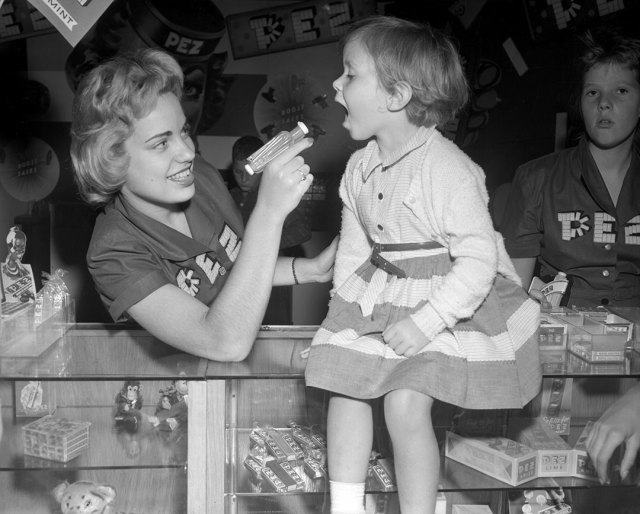 vintage image of a young girl eating pez at the CNE 1954