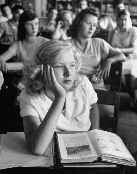 A girl daydreaming during class, Florida, March 1947.