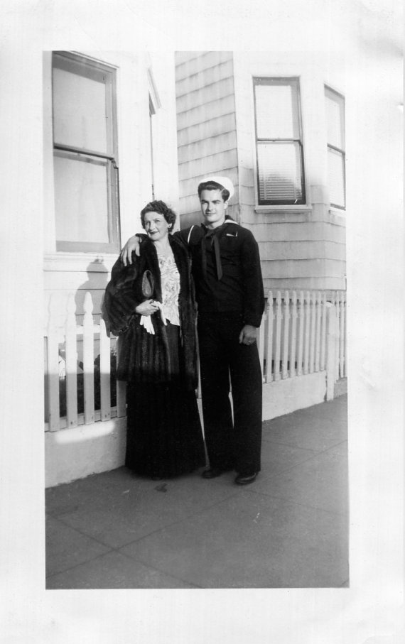 1940s image of sailor with his mother vintage