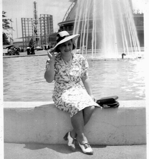 1940s woman at a fountain, vintage image