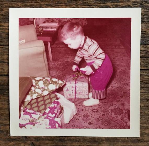 1957 vintage image of a little boy with presents
