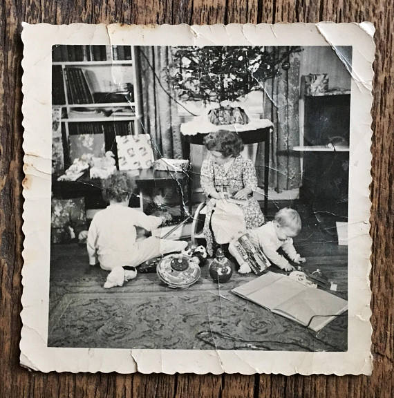 vintage photo of kids opening gifts on christmas morning 1940s 1950s