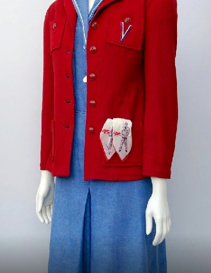 Black cotton skirt and red and blue striped cardigan sweater (1944 - 1946)