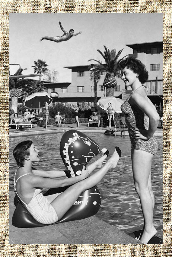 Vintage black and white photograph of two girls by the pool. Las Vegas, 1955