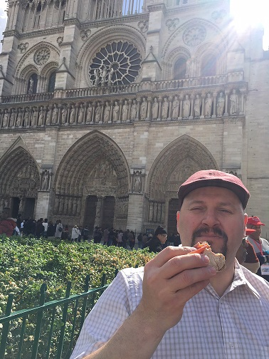 Eating French Bread in front of the Notre Dame Paris France-Vitnage Inn Blog