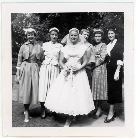 1950s bride on her wedding day, glowing surrounded by her ladies vintage photo