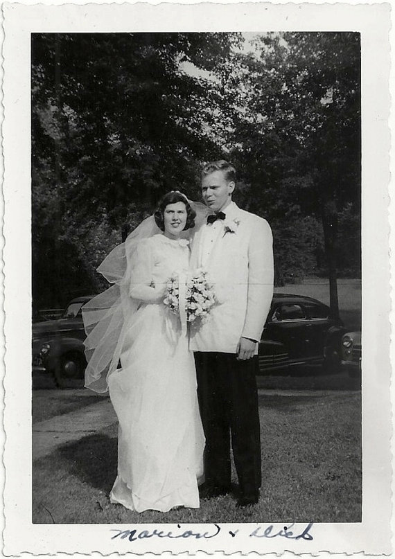 1950s vintage wedding photo of the bride and the groom