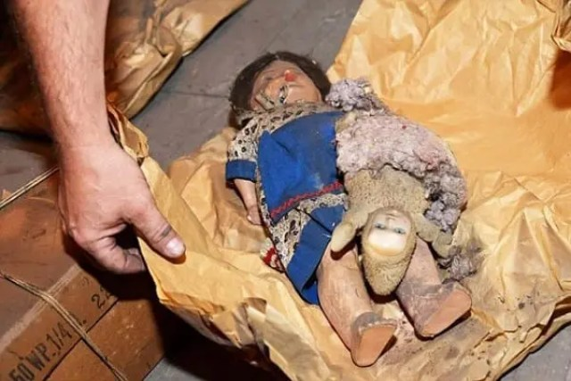 "Pic shows: A doll found in the attics. This is the moment an elderly man was temporarily reunited with family property that had been hidden when he was a 13-years-old and his family were evicted in one of largest mass expulsions the world has ever seen. Rudi Schlattner was forced to flee the family casa that had been built by his merchant father after the end of World War II as part of a mass expulsion of Germans from Czechoslovakia after World War II. The destruction of World War II had caused enormous hatred in Czechoslovakia of its ethnic German population, and the government under Czechoslovak President Edvard Benes ordered the ""final solution of the German question"" by evicting all ethnic Germans from the country. Thousands died during the forced expulsions of 1.6 million ethnic Germans their homes and into the American zone West Germany. These were the fortunate ones, and a further 800,000 were sent to the Soviet zone. Rudi and his family were among those that ended up in the American zone, and before they left they had time to hide their property in the attic of the family home. He said ""We thought we would one day return, and that would find a property there."" Now in his 80s, he realised that this would now never happen and has now returned to make sure that even if he is not allowed to have the family property back, at least it will not be forgotten and wanted to make sure people understood who it 11 belonged to and why it was there. He contacted municipal officials in the village of Libouch in north-western Czech Republic who used the family casa now as a kindergarten, and where it was a revelation that the items had been hidden in the roof of the refurbishments carried out including the roof. But Rudi's father had done such a good job of hiding it, that nobody had discovered them. He said: ""My father built the villa in 1928 and 1929. He always thought that one day we would return and get it back."" He was accompanied on the visit to the building by employees of a museum in the nearby town of Usti nad Labem together with the mayor of Libouch, manager of the kindergarten, archeologist and employees of the museum. After 70 years it was hard for him to find the exact hiding place, but the 70 packages were eventually found under the roof. Museum assignee Tomas Okurka told Czech daily newspaper Blesk: ""Mr Schlattner was tapping the roof's boards with a small hammer. All of them had the same sound. Then he tried to find a string which was supposed to detach the boards which was a system set up by his father. ""He told his son that he would only have to pull the string in order to detach the boards and suddenly he found the string, and when he pulled it two boards detached and the shelter full of objects untouched for 70 years appeared. ""It took too long and we thought that the shelter had perhaps been discovered and the items removed during the roof reconstruction and we would not find anything. But suddenly he found the string."" He added: ""The packages were very skilfully hidden in the vault of a skylight. It was incredible how many things fitted in such a small space. It took more than one hour until we put everything out."" There were some packages wrapped in brown paper and some unwrapped objects such as skis, hats, clothes-hangers, newspapers and paintings by Josef Stegl who also lived in the house during WWII. Mr Okurka said: ""We were surprised that so many ordinary things were hidden there. Thanks to the circumstances these objects have a very high historical value."" Because when the Germans were expelled all of their property was also confiscated, the items in the attic remain under the ownership of the Czech government. All the packages were taken to a museum in the town of Usti nad Labem where they have been unpacked, analyzed and filed. So far several packages have been unpacked. Some umbrellas, hats, badges, paper weights, paintings, pens, school tables, unpacked cigarettes, socks, books, sewing kits and much more. Everything was in very good condition according to the historians. Manager of the museum Vaclav Houfek said: ""Such a complete finding of objects hidden by German citizens after the war is very rare in this region."" Because they are the property of the Czech Republic their previous owner cannot claim them back. It is not yet been decided which institution will take the objects. Mr Schlattner is reportedly not bitter over the fact that his family's treasures cannot be returned to him and promised to help with identification of the objects, although his health is not good. Tomas Okurka said: ""We can get details and a very strong personal story by talking to him about them."" (ends)"