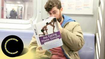 Reading Books With Outrageous Covers On The Subway