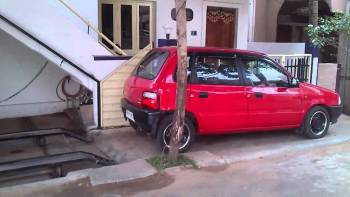 Genius Parks His Compact Car Under Stairs