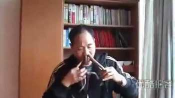 Chinese Entertainer Pushes Snakes Through His Nose