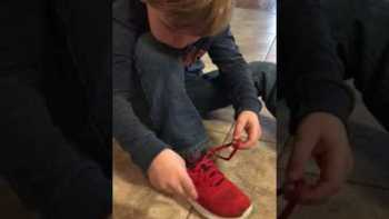 Little Boy Demonstrates His Cool Shoe Tying Trick