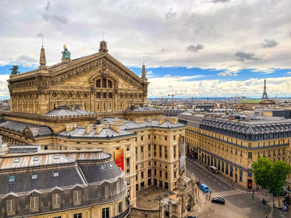 View of Opéra Garnier, Eiffel Tower and Parisian roofs