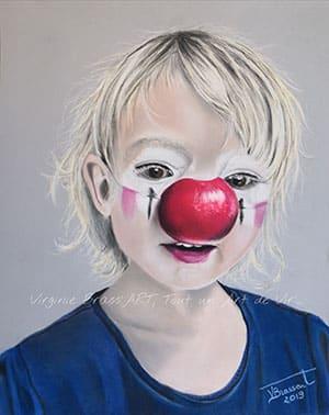 Dessin aux pastels secs d'une petite fille avec un nez de clown