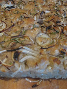Sourdough focaccia topped with onion, garlic, rosemary and sea salt