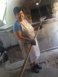 La senora Olivia in front of her oven