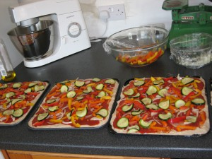 Beautiful pizzas ready for the oven, prepared by Bread Angel, Tony Meredith,  for the Tring Festival